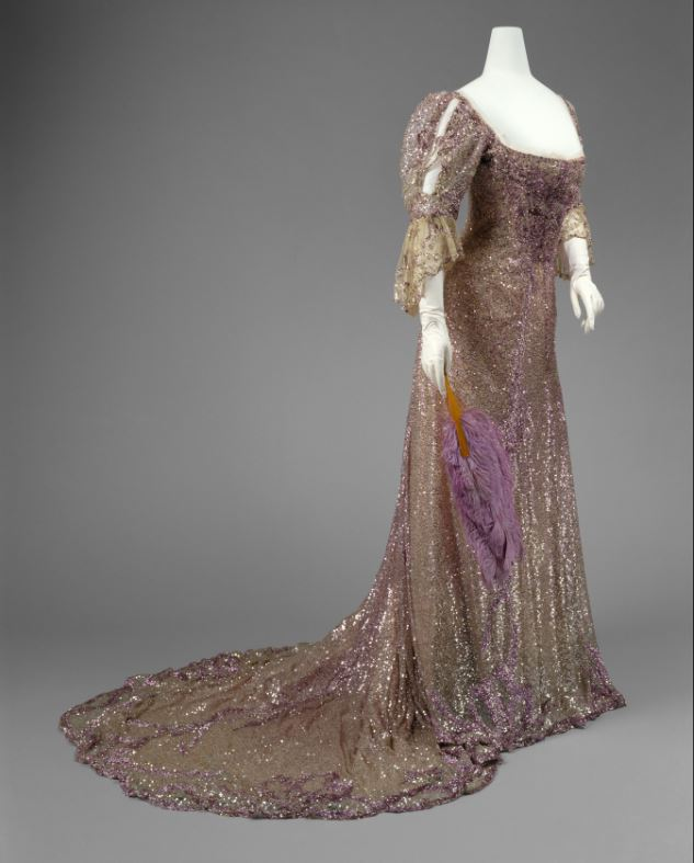 Henriette Favre (French) Evening Dress, 1902 Worn by Queen Alexandra (British, born Denmark, 1844–1925) Mauve silk tulle, sequins The Metropolitan Museum of Art, Gift of Miss Irene Lewisohn, 1937 (C.I. 37.44.1) Photo: © The Metropolitan Museum of Art, by Karin L. Willis